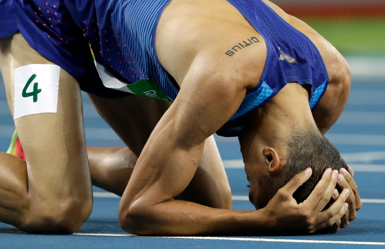 United States' Matthew Centrowitz wins the gold medal after the men's 1500-meter final during the athletics competitions of the 2016 Summer Olympics at the Olympic stadium in Rio de Janeiro, Brazil, Saturday, Aug. 20, 2016. (AP Photo/David J. Phillip)