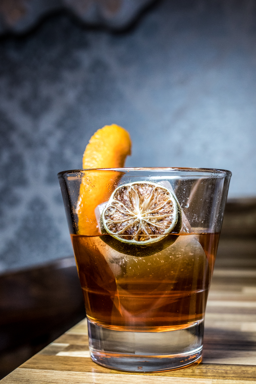 Rum Old Fashioned: Plantation Pineapple and 5 Years Rum, Angostura bitters, and simple syrup garnished with an orange peel and a dehydrated lime slice / Image: Catherine Viox{ }// Published: 3.3.20