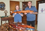 Karla and Vern Gebhart of Stockbridge pose with some of their sturgeon decoys, Jan. 30, 2014. (WLUK/Emily Deem)