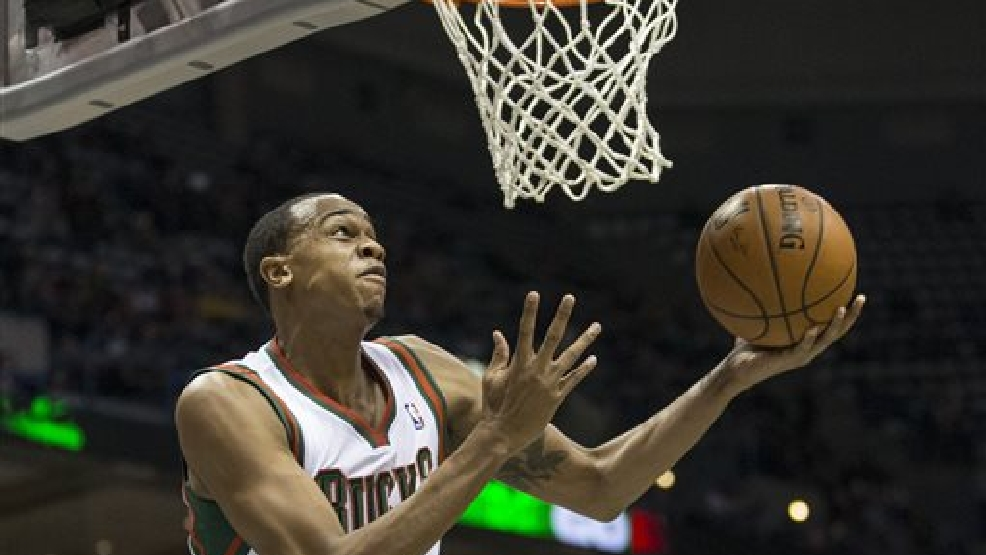 Milwaukee Bucks' John Henson lays the ball in against the Los Angeles Lakers during the second half of an NBA basketball game Thursday, March 27, 2014, in Milwaukee. (AP Photo/Tom Lynn)