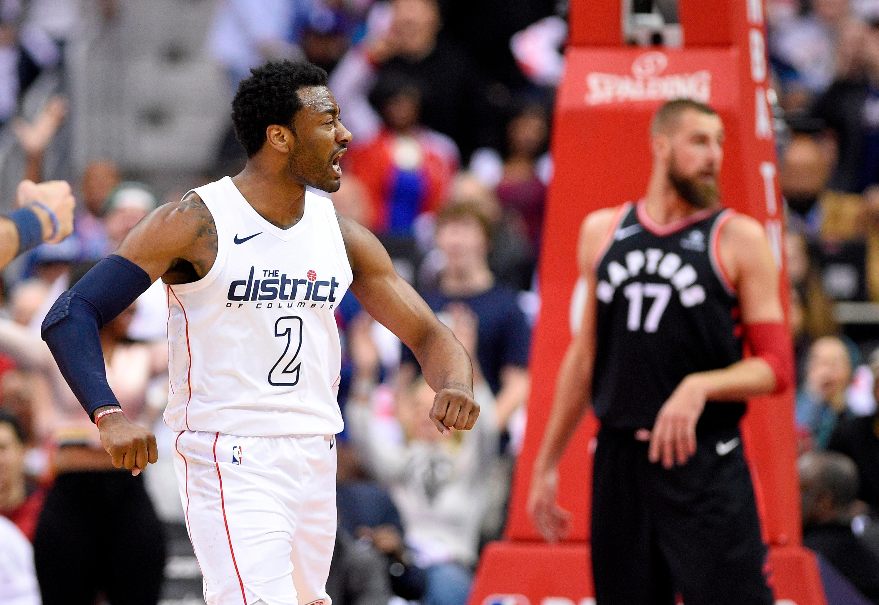 Washington Wizards Guard John Wall 2 Reacts After His Dunk In Front Of Toronto