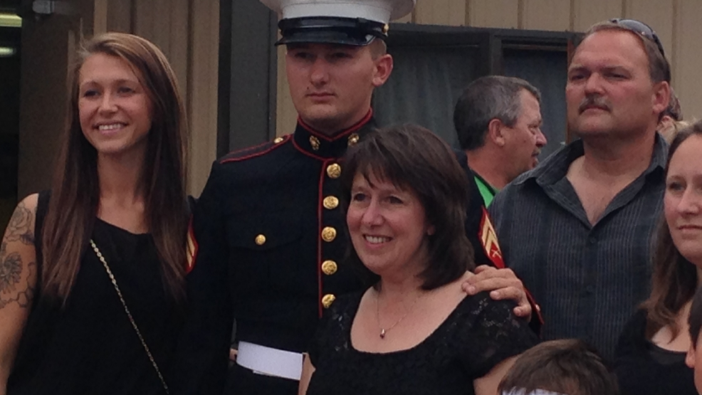 Cpl. Randy Smith poses for a picture with his wife, Gabrielle, and mother, Sheila. R- Sheila Smith (Cpl. Smith's mom)