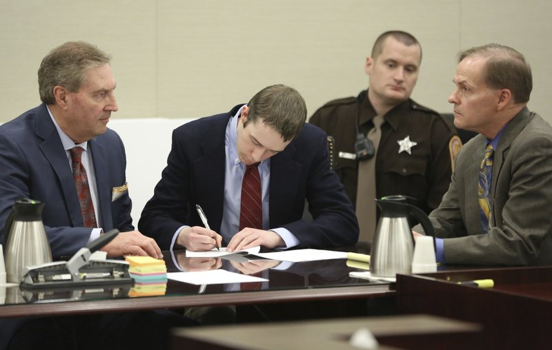 <p>David Eisenhauer, center, signs a no contest plea next to his defense attorney Tony Anderson, left, during a hearing in Montgomery County Circuit Court in Christiansburg, Va., Friday, Feb. 9 2018. Eisenhauer, a former Virginia Tech student, pleaded no contest on Friday, in the 2016 killing of a 13-year-old girl. A plea of no contest means a defendant acknowledges there's enough evidence to convict him, but doesn't admit he committed the crime. The plea has the same effect as a guilty plea. (Matt Gentry/The Roanoke Times via AP, Pool)</p>