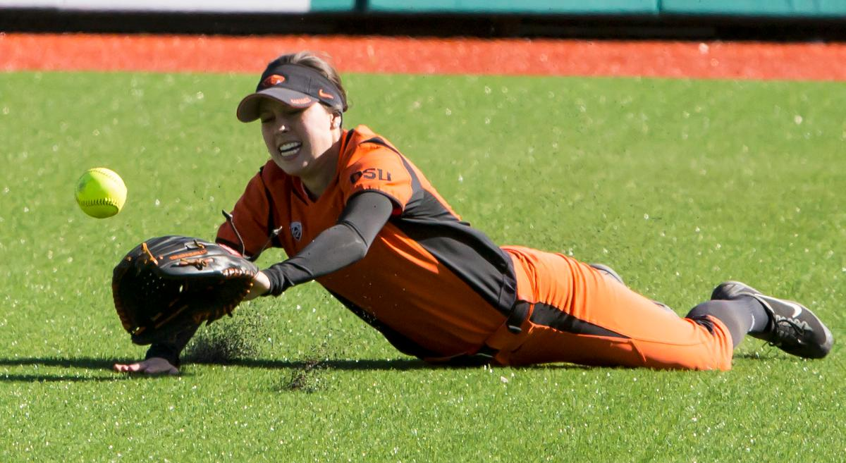 Oregon State center fielder Jessica Garcia (#3) dives to catch a hit in the outfield. The Oregon Ducks defeated the Oregon State Beavers seven to zero on Sunday, April 30, 2017. The Ducks' victory marked the third victory of the three game sweep against the Beavers. Photo by Ben Lonergan, Oregon News Lab