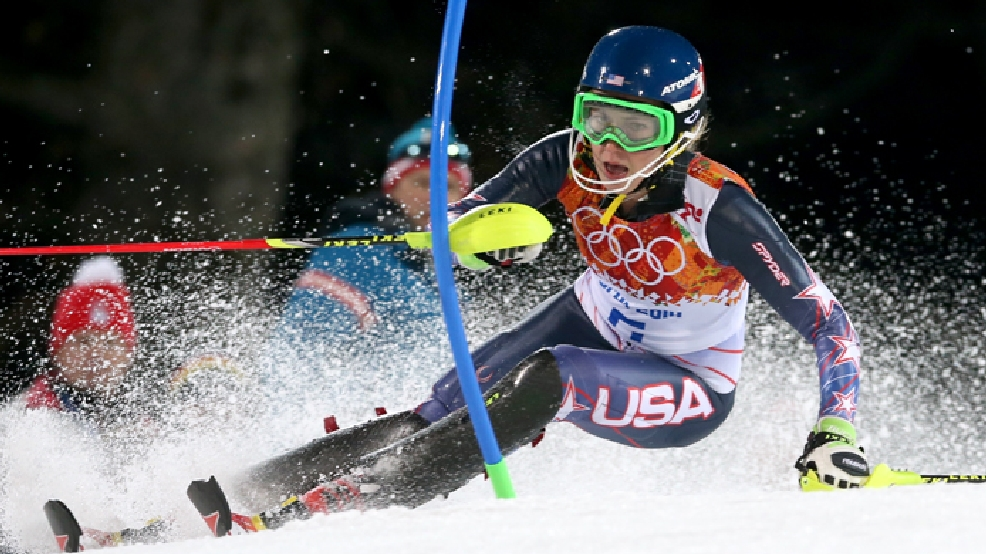 Gold medal winner Mikaela Shiffrin of the United States skis past a gate in the second run of the women's slalom at the Sochi 2014 Winter Olympics, Friday, Feb. 21, 2014, in Krasnaya Polyana, Russia. (AP Photo/Luca Bruno)