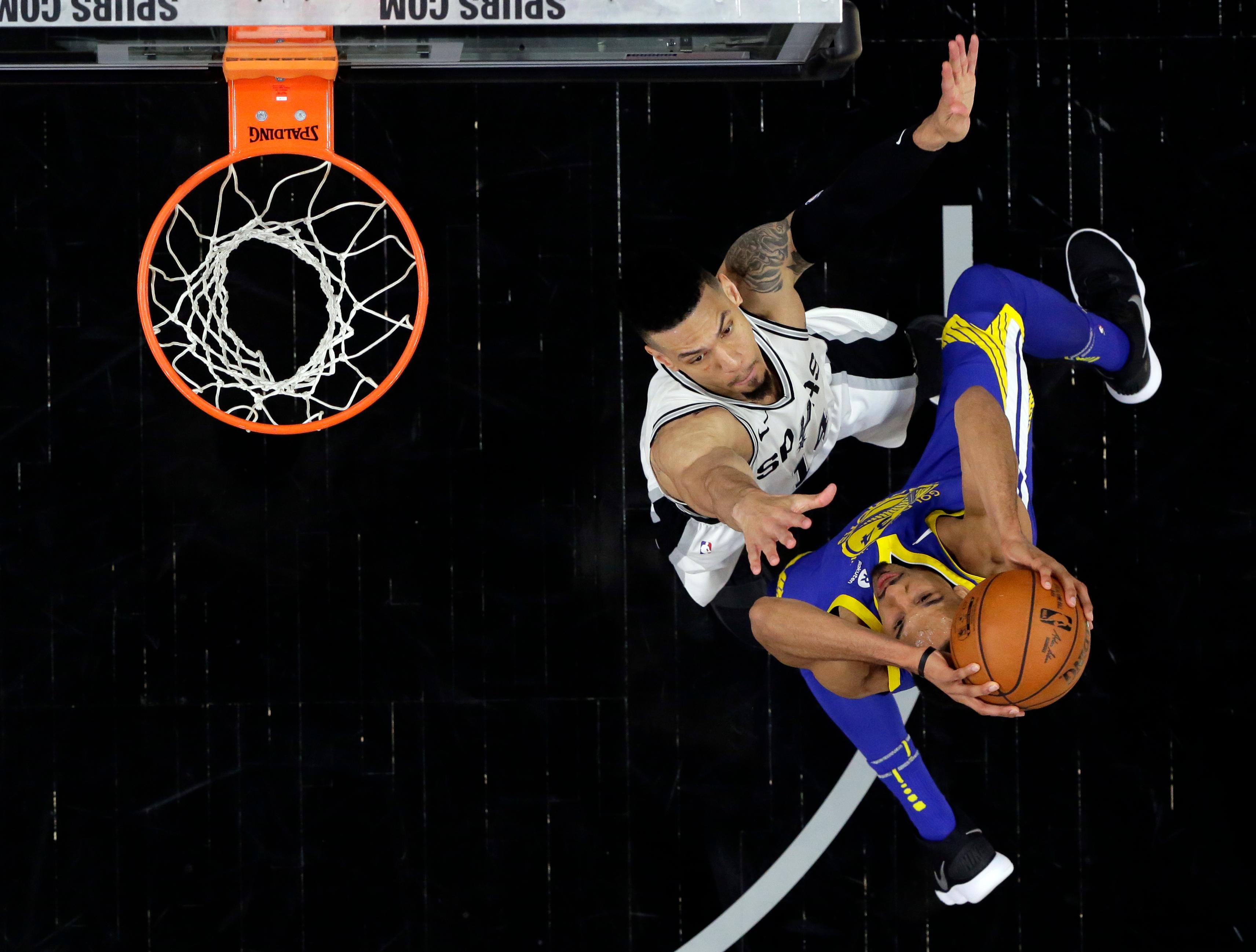 San Antonio Spurs' Danny Green (14) defends as Golden State Warriors guard Shaun Livingston (34) shoots during the second half of Game 3 of a first-round NBA basketball playoff series in San Antonio, Thursday, April 19, 2018. (AP Photo/Eric Gay)