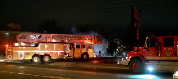 First responders fight fire at Mr. B's grocery store in Flint. (Photo: WEYI/WSMH)