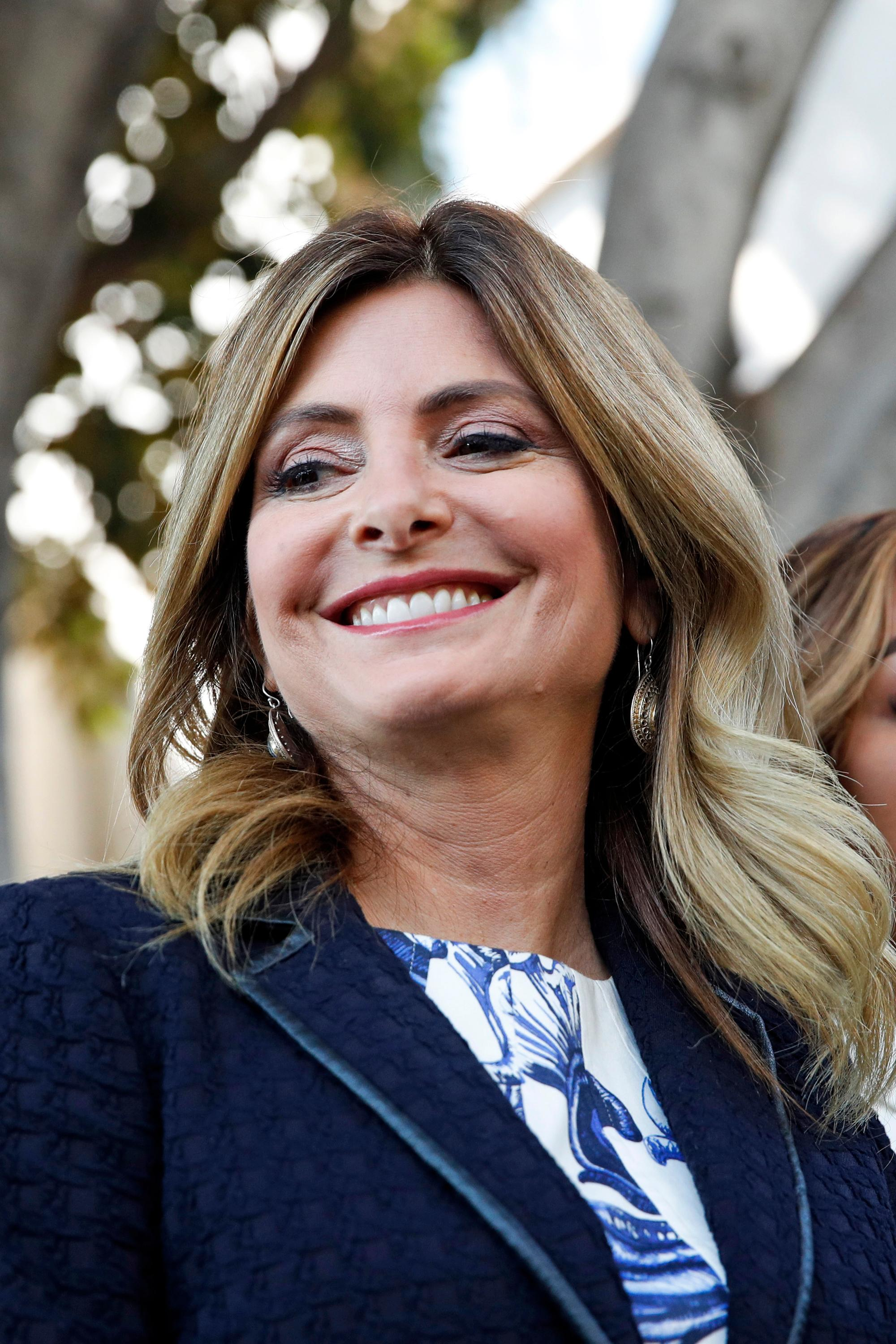 "FILE - In this July 10, 2017 file photo, attorney Lisa Bloom stands outside a courthouse in downtown Los Angeles.  Bloom says she is no longer representing movie mogul Harvey Weinstein as he confronts sexual harassment allegations. Bloom posted Saturday, Oct. 7,  on Twitter that she has resigned as an adviser to Weinstein. She added that he and his board of directors are, quote, ""moving toward an agreement.(AP Photo/Jae C. Hong)"
