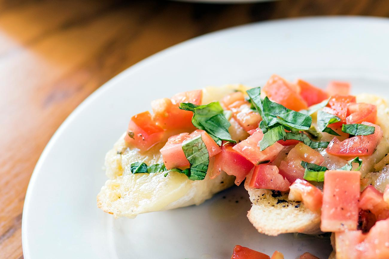 Bruschetta, topped with tomatoes from the garden{ }/ Image: Allison McAdams // Published: 10.21.18