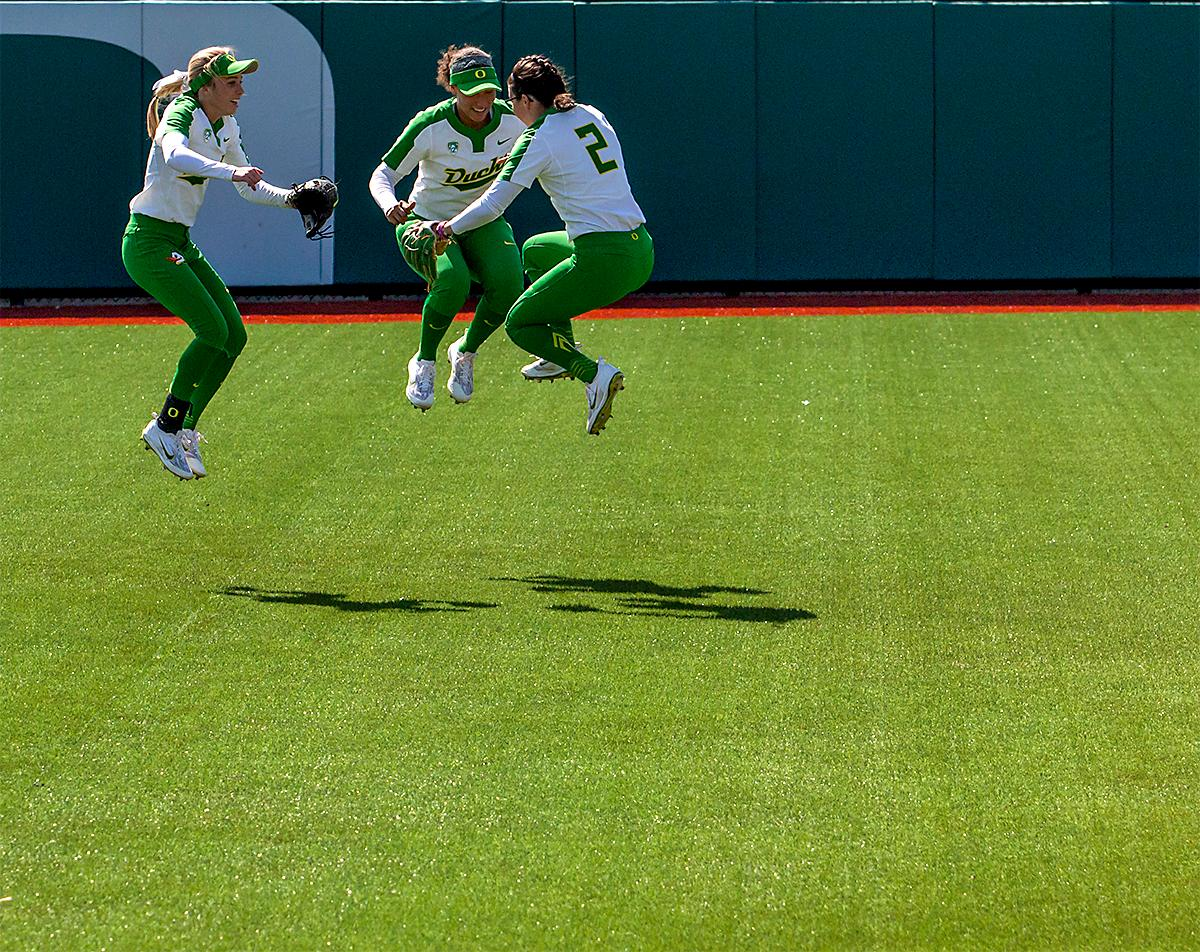 The Duck's outfield team take a jump together before the start of the game. The Oregon Ducks Softball team took their third win over the Arizona Sun Devils, 1-0, in the final game of the weekends series that saw the game go into an eighth inning before the Duck?s Mia Camuso (#7) scored a hit allowing teammate Haley Cruse (#26) to run into home plate for a point. The Ducks are now 33-0 this season and will next play a double header against Portland State on Tuesday, April 4 at Jane Sanders Stadium. Photo by August Frank, Oregon News Lab