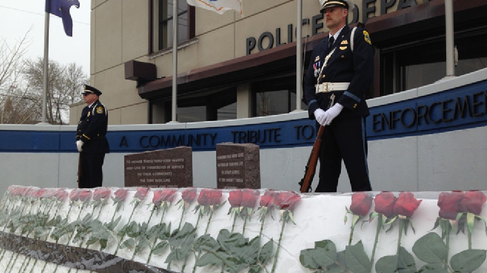 Police officers stand watch at the Community Tribute to Law Enforcement in front of the Green Bay Police Department, May 15, 2014. (WLUK/Mike Raasch)