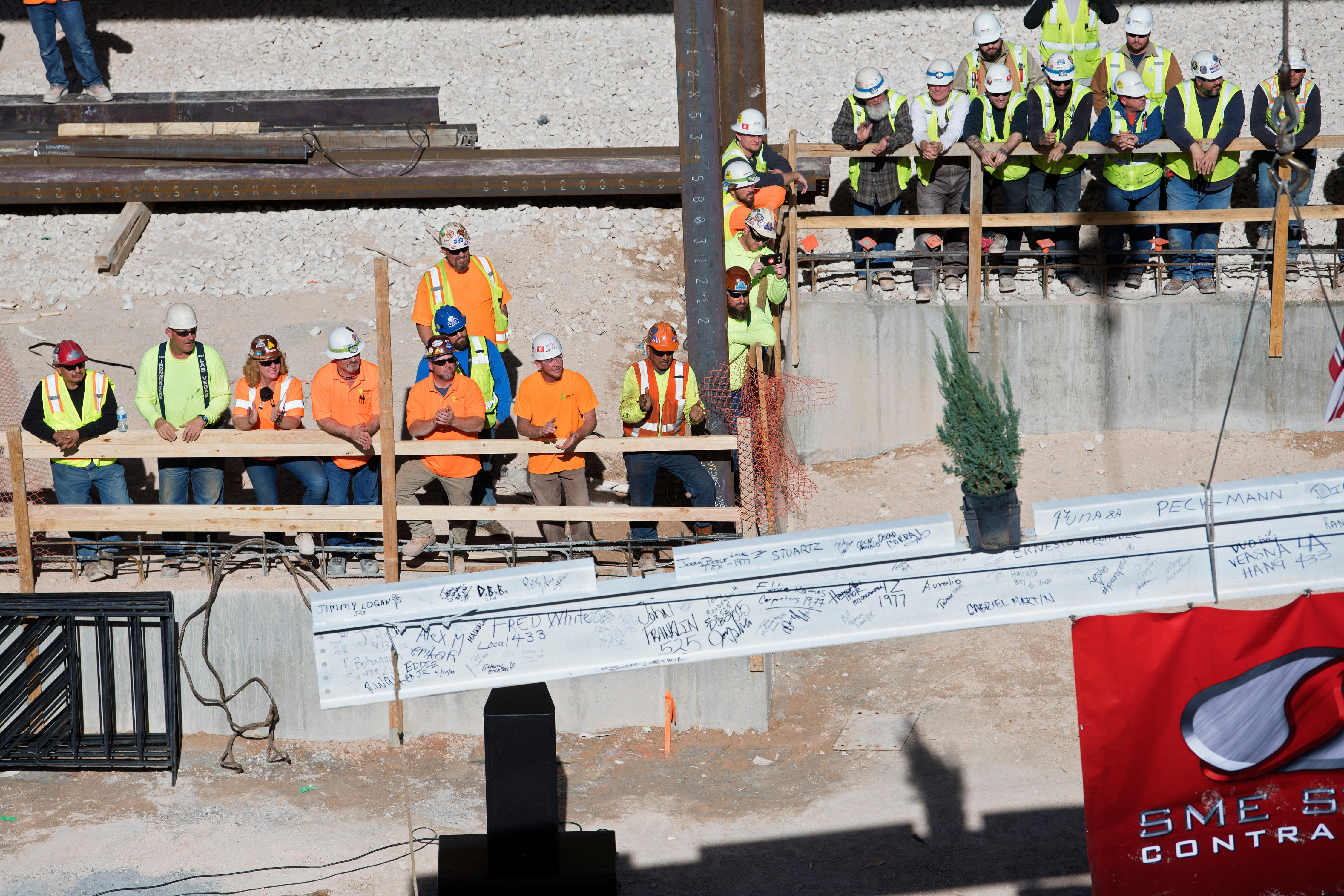Iron workers appeal as the final beam is raised into place during the topping off ceremony for MGM Grand's expanded conference center Tuesday, January 30, 2018. CREDIT: Sam Morris/Las Vegas News Bureau
