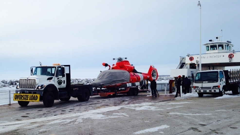A Dolphin helicopter from Coast Guard Air Station Traverse City, Mich., arrives at Northport Pier in Door County, on a flatbed trailer March 3, 2014 following a brief ferry transit from Washington Island. (U.S. Coast Guard photo)