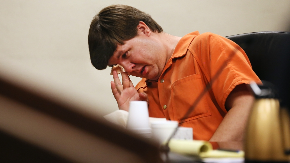 Justin Ross Harris, the father of a toddler who died after police say he was left in a hot car for about seven hours, wipes his eye as he sits during his bond hearing in Cobb County Magistrate Court, Thursday, July 3, 2014, in Marietta, Ga. (AP Photo/Marietta Daily Journal, Kelly J. Huff, Pool)