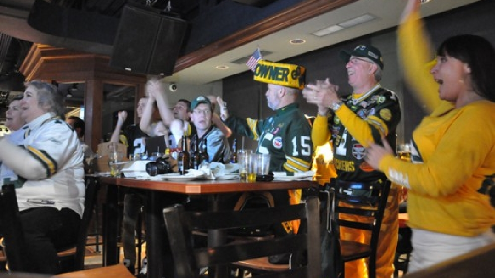 Green Bay Packers fans cheer the selection of UCLA defensive end Datone Jones during an NFL Draft party at Curly's Pub in the Lambeau Field Atrium, April 25, 2013. (WLUK/Ben Krumholz)
