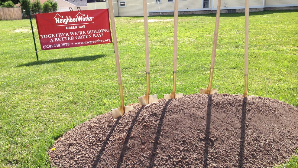 NeighborWorks broke ground on a three-unit townhouse on Mather Street in Green Bay on Friday, June 13, 2014. (WLUK/Chris Bourassa)