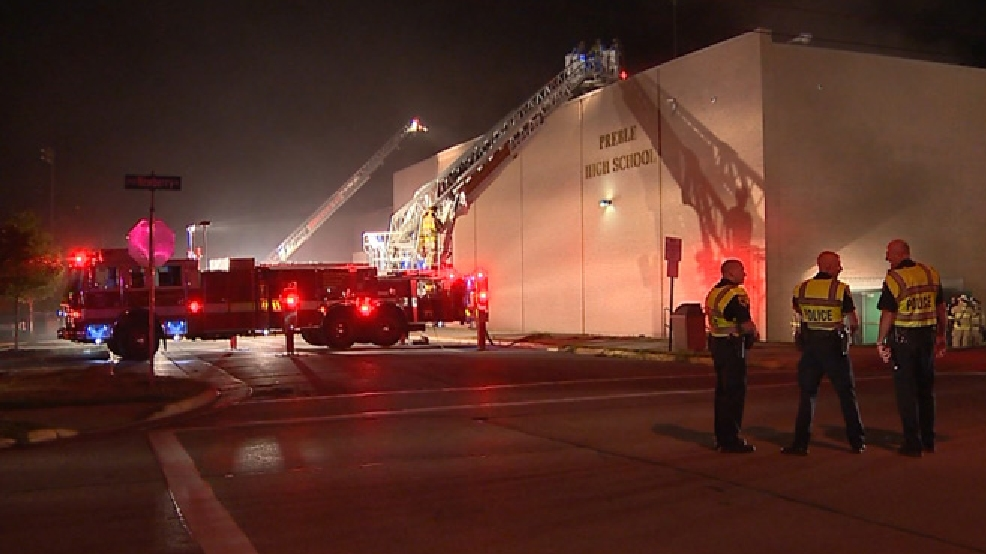 Firefighters battle a fire at the Preble High School gym in Green Bay, Aug. 8, 2014. (WLUK)