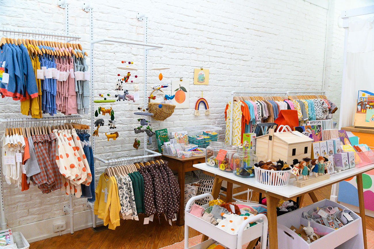 <p>Instead of seeing an empty storefront, Brittney and Suzy decided to open the concept to appeal to a different demo of potential Pike Street shoppers. The choice to start the baby products business was inspired by the birth of Brittney's own child. The shop formally opened in October 2019 and sells clothes, accessories, and gifts for children aged 0 to 5 years old. It also has its own online companion store. / Image: Phil Armstrong, Cincinnati Refined // Published: 12.18.19</p>