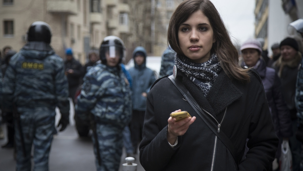 Member of the Pussy Riot punk group, Nadezhda Tolokonnikova stands outside Zamoskvoretsky District Court in Moscow, Russia, Monday, Feb. 24, 2014, where hearings started against opposition activists detained on May 6, 2012 during the rally at Bolotnaya Square. (AP Photo/Alexander Zemlianichenko)