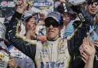 Brad Keselowski holds up the Kobalt 400 trophy after winning a NASCAR Sprint Cup Series auto race on Sunday, March 9, 2014, in Las Vegas. Keselowski overtook Dale Earnhardt Jr. on the last lap when Earnhardt ran out of fuel. (AP Photo/Julie Jacobson)