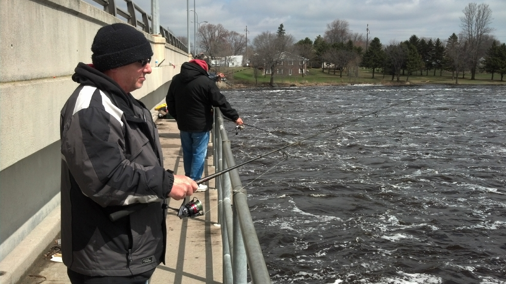 Anglers fish for walleye off the Hattie Street Bridge in Marinette