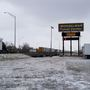 Hundreds of truck drivers wait out slick roads at truck stops