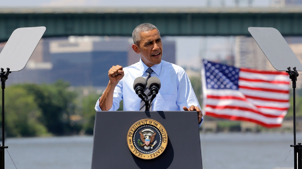 President Barack Obama speaks in front of the Interstate 495 bridge over the Christina River near Wilmington, Del., Thursday, July 17, 2014. (AP Photo/Patrick Semansky)