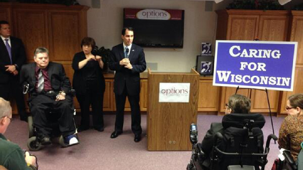 Republican Gov. Scott Walker announces the expansion of the Family Care program in Green Bay on Monday, April 21, 2014. (WLUK/Andrew LaCombe)