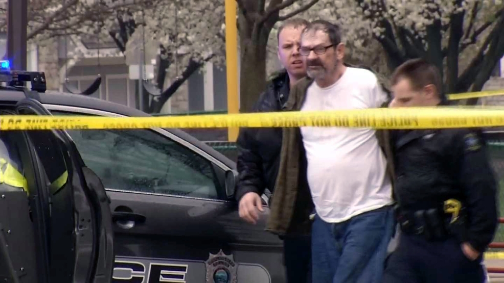 In this Sunday, April 13, 2014 image from video provided by KCTV-5, Frazier Glenn Cross, also known as Frazier Glenn Miller, is escorted by police in an elementary school parking lot in Overland Park, Kan. (AP Photo/KCTV-5)