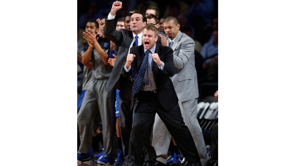 Duke assistant coach Steve Wojciechowski and head coach Mike Krzyzewski, second from left, react to a Blue Devil basket against the Georgia Tech in the first half of a game Tuesday, Feb. 18, 2014, in Atlanta. (AP Photo/John Bazemore)