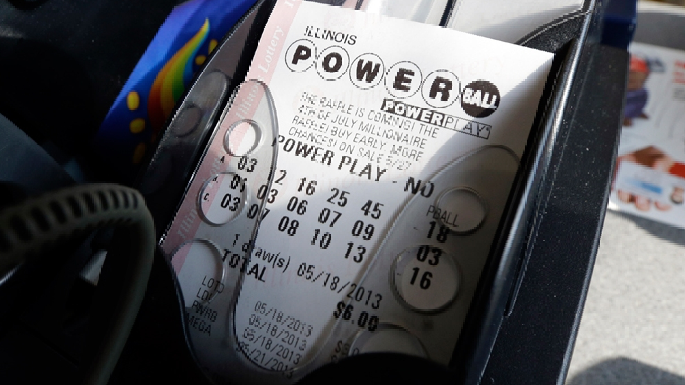 A Powerball lottery ticket is printed out of a lottery machine at a convenience store in Chicago on in this May 18, 2013 file photo. (AP Photo/Nam Y. Huh, FILE)