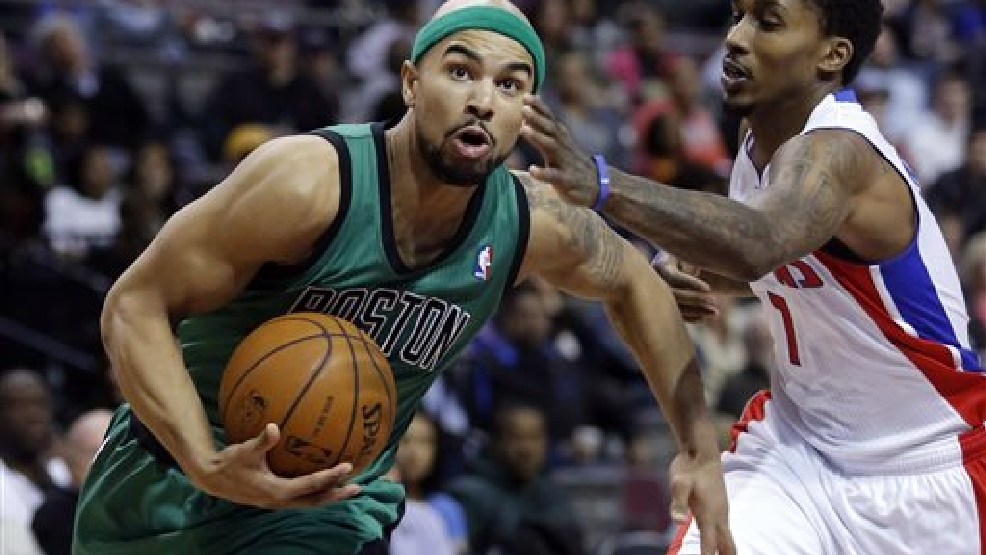 Boston Celtics guard Jerryd Bayless, left, drives to the basket against Detroit Pistons guard Brandon Jennings during the second half of an NBA basketball game Saturday, April 5, 2014, in Auburn Hills, Mich. The Pistons defeated the Celtics 115-111. (AP Photo/Duane Burleson)