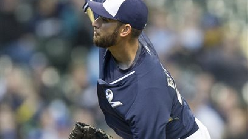 Milwaukee Brewers' Marco Estrada pitches to Kansas City Royals' Norichika Aoki during the first inning of an exhibition baseball game Saturday, March 29, 2014, in Milwaukee. (AP Photo/Tom Lynn)