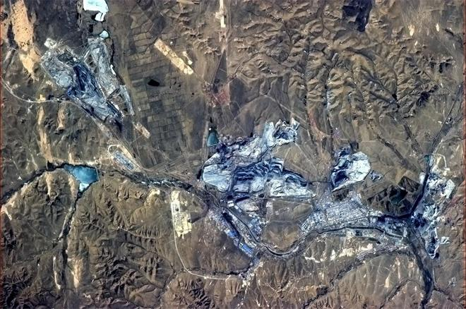 Mining town in northern China - the open pits gleam with blue from space. (Photo & Caption: Col. Chris Hadfield, NASA)
