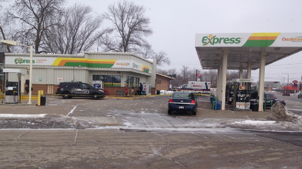 Neenah police investigate an armed robbery at a gas station on S. Commercial St., Feb. 21, 2014. (WLUK/Chad Doran)