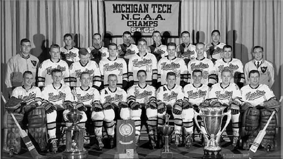 Michigan Tech's 1965 NCAA champions. Front row from left: Rick Best, Bruce Riutta, Terry Ryan, Pete Leiman, Al Holm, Rick Yeo, Dennis Huculak, Fred Dart, Tony Esposito.  Middle row: Student Manager Wallace Reid, Gary Milroy, Bob Wilson, Bob Toothill, Bob Brooks, Tom Steele, Roy Heino, Wayne Weller, Head Coach John MacInnes. Back Row: Trainer Brad Taylor, David Confrey, Colin Patterson, Mike Gorman, Joe Galetto, Ed Caterer, and Steve Yoshino, Manager Wally Reid. (Courtesy Michigan Technological University Hockey Photograph Collection)