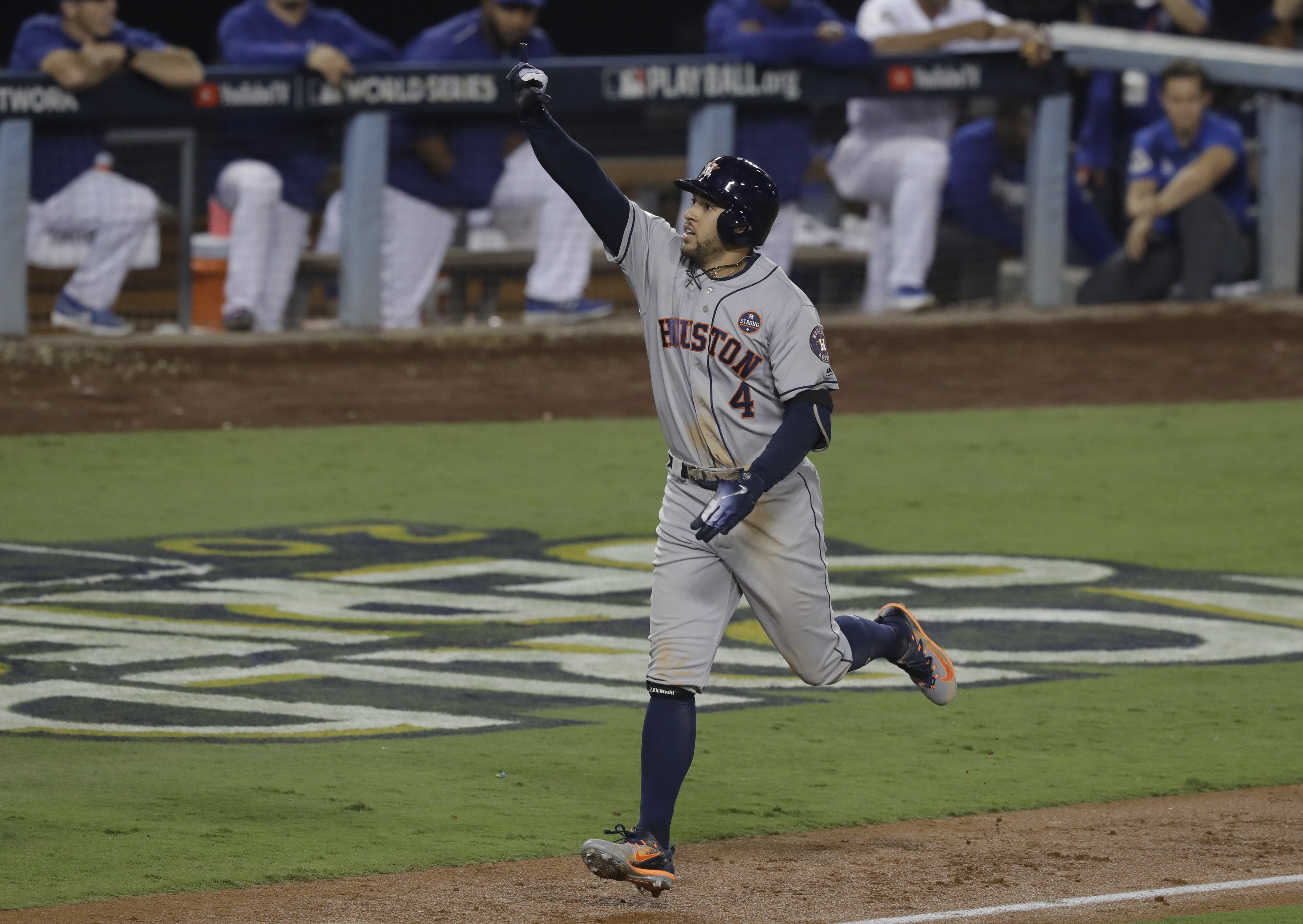 Houston Astros' George Springer celebrates after hitting a two-run home run during the 11th inning of Game 2 of baseball's World Series against the Los Angeles Dodgers Wednesday, Oct. 25, 2017, in Los Angeles. (AP Photo/Alex Gallardo)