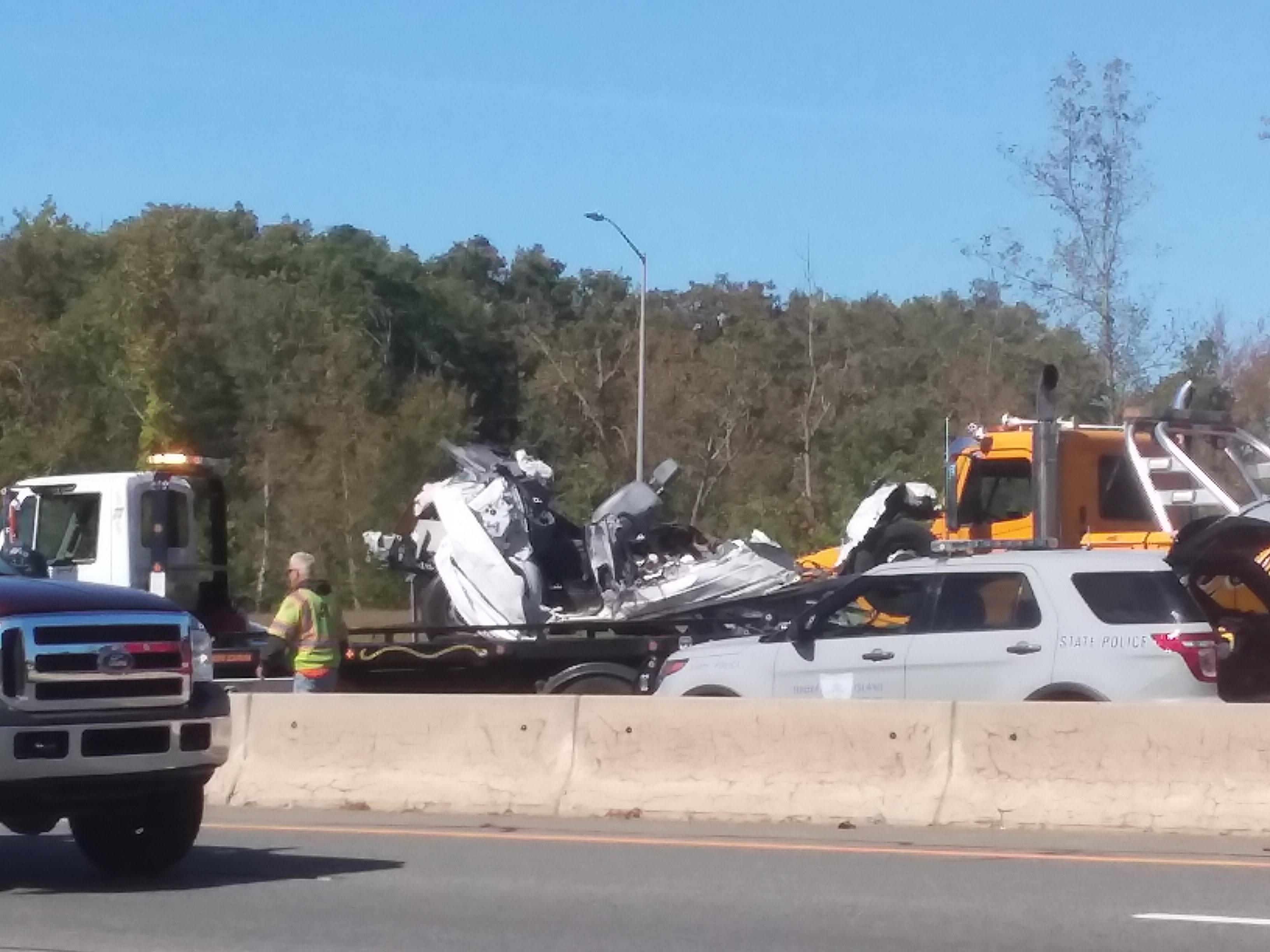 A box truck was crushed between two tractor-trailer trucks on Interstate 195 west in East Providence, Tuesday, Oct. 3, 2017. (WJAR)<p></p>