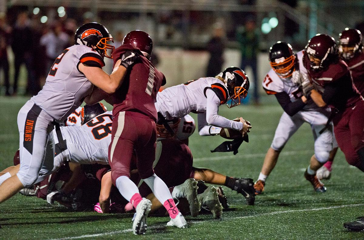 Roseburg Indians quarterback Collin Warmouth (#16) dives across the goal line on a quarterback keeper to score against the Willamette Woverines. Roseburg defeated Willamette 21-20 at Wolverine Stadium. Photo by Dan Morrison, Oregon News Lab