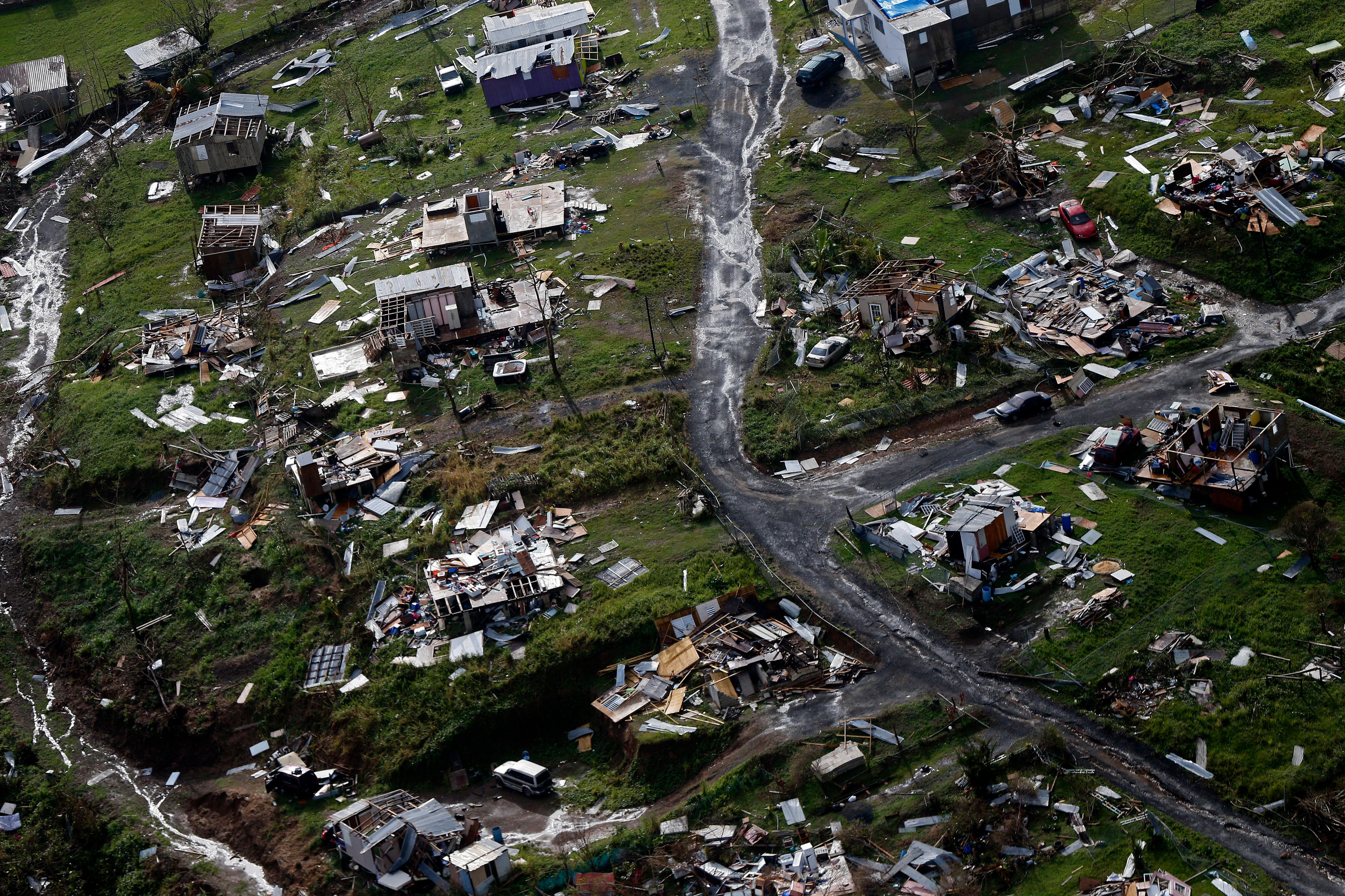 Destroyed communities are seen in the aftermath of Hurricane Maria in Toa Alta, Puerto Rico, Thursday, Sept. 28, 2017.  (AP Photo/Gerald Herbert)