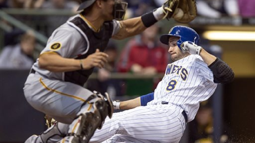 Milwaukee Brewers' Ryan Braun, right, slides ahead of the tag by Pittsburgh Pirates' Tony Sanchez during the fourth inning of a baseball game on Sunday, April 13, 2014, in Milwaukee. (AP Photo/Tom Lynn)