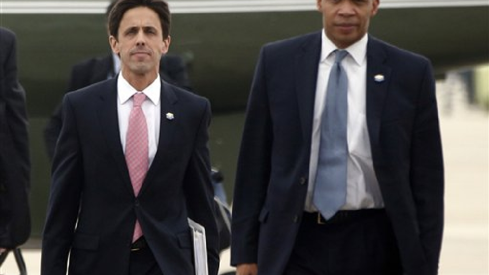This Oct. 30, 2013, file photo shows David Simas, President Barack Obama's political director, left, and Rob Nabors, Deputy Chief of Staff as they accompany the president to board Air Force One at Andrews Air Force Base, Md. The White House is opposing congressional Republicans' subpoena to Simas to testify on Capitol Hill this week. White House counsel Neil Eggleston said in a letter that the House Oversight Committee's demand that Simas testify threatens the president's independence and ability to get candid advice to carry out his constitutional duties. (AP Photo/Charles Dharapak, File)