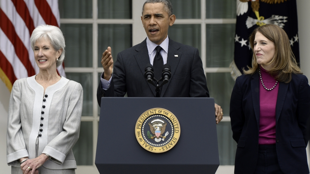President Barack Obama, flanked by outgoing Health and Human Services Secretary Kathleen Sebelius, left, and his nominee to replace her, current Budget Director Sylvia Mathews Burwell, speaks event in the Rose Garden of the White House in Washington, Friday, April 11, 2014, where he made the announcement. (AP Photo/Susan Walsh)