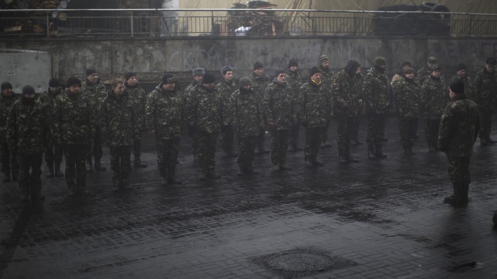 Ukrainian recruits line up as they receive military instructions from a commander at a recruitment center in Kiev's Independence Square, Ukraine, Tuesday, March 4, 2014. Vladimir Putin ordered tens of thousands of Russian troops participating in military exercises near Ukraine's border to return to their bases as U.S. Secretary of State John Kerry was on his way to Kiev. Tensions remained high in the strategic Ukrainian peninsula of Crimea with troops loyal to Moscow fired warning shots to ward off protesting Ukrainian soldiers. (AP Photo/Emilio Morenatti)