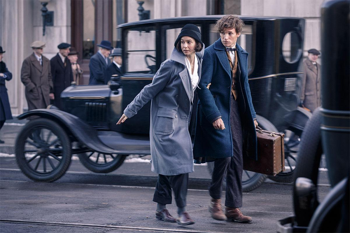"(L-r) KATHERINE WATERSTON as Tina and EDDIE REDMAYNE as Newt in Warner Bros. Pictures' fantasy adventure ""FANTASTIC BEASTS AND WHERE TO FIND THEM,"" a Warner Bros. Pictures release. Copyright: © 2016 WARNER BROS ENTERTAINMENT INC. ALL RIGHTS RESERVED. Photo Credit: Jaap Buitendijk"