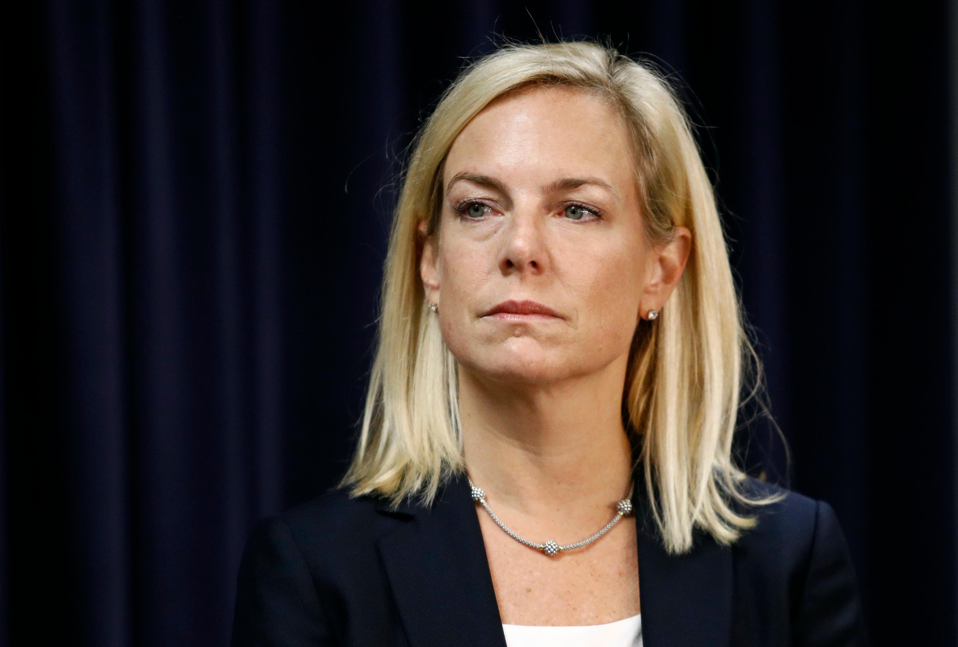 Secretary of Homeland Security Kirstjen Nielsen listens as Attorney General Jeff Sessions speaks at a news conference in Baltimore, Tuesday, Dec. 12, 2017, to announce efforts to combat the MS-13 street gang with law enforcement and immigration actions. (AP Photo/Patrick Semansky)