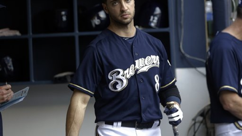Milwaukee Brewers' Ryan Braun in the dugout during the seventh inning of a baseball game against the Cincinnati Reds Wednesday, July 10, 2013, in Milwaukee. (AP Photo/Morry Gash)