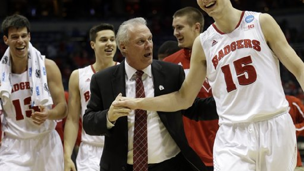 Wisconsin head coach Bo Ryan celebrates with Wisconsin forward Sam Dekker (15) after  a third-round game against the Oregon in the NCAA college basketball tournament Saturday, March 22, 2014, in Milwaukee. Wisconsin won 82-77. (AP Photo/Morry Gash)