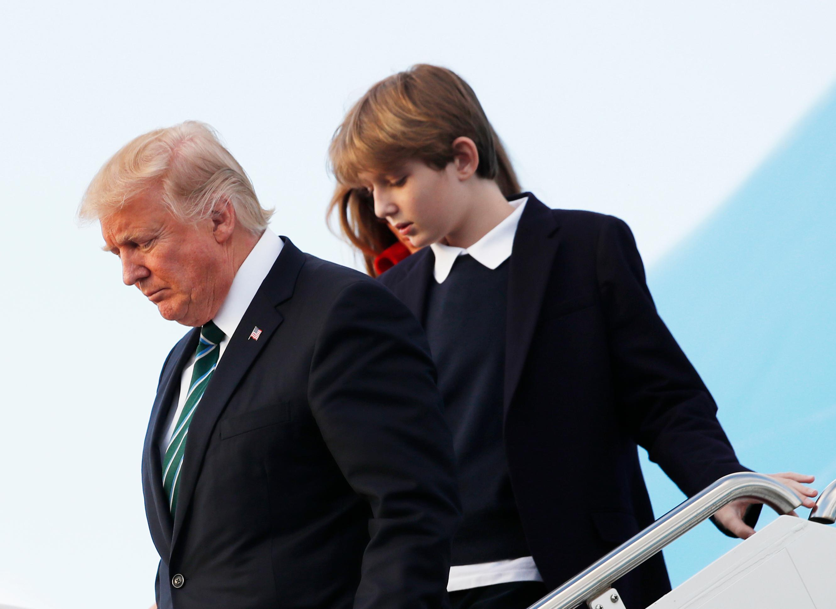 In this photo taken March 17, 2017, Barron Trump, with his father President Donald Trump and mother, first lady Melania Trump, disembark from Air Force One upon arrival at Palm Beach International Airport in West Palm Beach, Fla. First lady Melania Trump has announced that her son, Barron, will attend a private Episcopal school in Maryland beginning this fall. (AP Photo/Manuel Balce Ceneta)