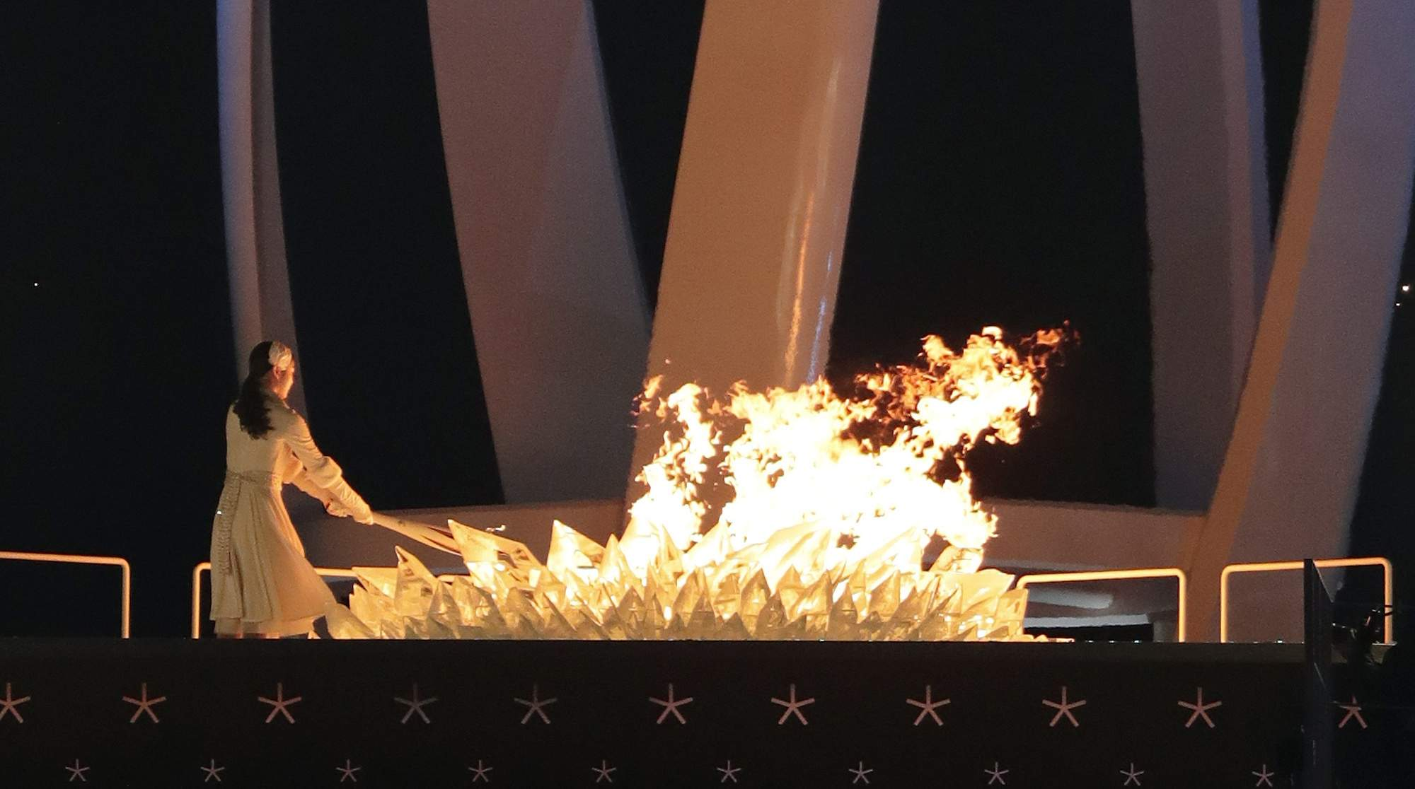 Yuna Kim, former South Korean figure skater lights the Olympic cauldron during the opening ceremony of the 2018 Winter Olympics in Pyeongchang, South Korea, Friday, Feb. 9, 2018. (AP Photo/Julie Jacobson)